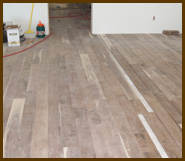 This is what our hardwood flooring installation looks like before we add the finish.